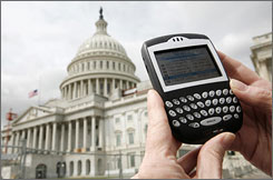 A journalist looks at her Blackberry communication device on Capitol Hill.      Self-confessed BlackBerry addicts experienced both a sense of panic, and relief, as the mobile e-mail device's network stalled overnight.
