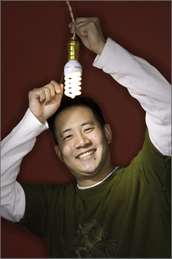 Andrew Ma replaced more than 130 bulbs in his 5,800-square-foot home with compact fluorescents to save on energy bills.