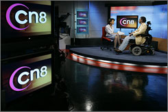CN8's Carla Showell-Lee, left, interviews Teddy Pendergrass, an advocate for people with spinal cord injuries in Philadelphia, Wednesday, May 9, 2007.