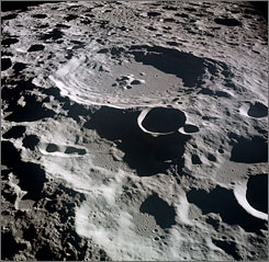 A sunlit lunar crater, Daedalus, on the Moon's far side.  Astronaut Michael Collins took the picture, in July 1969, from the Apollo 11 spacecraft in lunar orbit, as Neil Armstrong and Edwin Aldrin descended to the Moon's surface, and walked in sunlight.