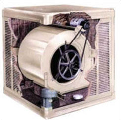 Cut-away photo of a swamp cooler. The fan draws warm outside air through the wet pads and blows the cooled-by-evaporation air throughout the house.