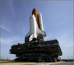 Atlantis makes the 3.4-mile journey to launch pad 39A at the Kennedy Space Center in Cape Canaveral on May 15.