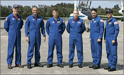 The crew of Space Shuttle Atlantis, from left, mission specialists' James Reilly, John Olivas, Steven Swanson, and Patrick Forrester, pilot Lee Archambault and commander Rick Sturckow at the Kennedy Space Center. Mission specialist Clayton Anderson, not pictured, was added to the crew just six weeks before the scheduled June 8 launch.