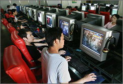 Chinese gamers play at an Internet cafe in Shanghai. China will license no new Internet cafes this year.