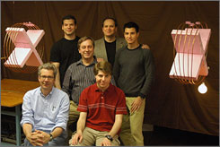 The MIT team that demonstrated wireless power transmission. Front row: Peter Fisher, left, and Robert Moffatt; second row: Marin Soljacic; third row: Andre Kurs, left, John Joannopoulos, and Aristeidis Karalis.