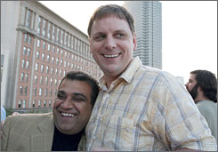 Om Malik, left, and Michael Arrington attend a Business 2.0 party in San Francisco in July 2006. Malik runs GigaOm, while Arrington leads TechCrunch.