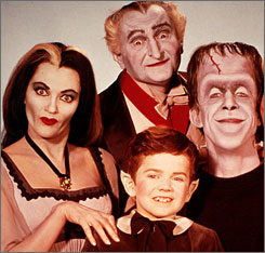 The cast of The Munsters. That's Herman on the right, whose identity thieves tried to sell in an underground chat room, not realizing he was a fictional character.