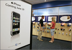 A poster promotes the arrival of Apple's iPhone at an AT&T store in Orem, Utah.