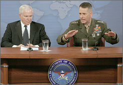 Joint Chiefs of Staff Chairman Peter Pace, right, gestures during a media roundtable with Defense Secretary Robert M. Gates at the Pentagon in Arlington, Virginia. Hackers broke into the Pentagon e-mail system, forcing a partial shutdown affecting as many as 1,500 workers yesterday.