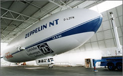The german-made Zeppelin NT is 250 feet long and holds 12 passengers.  The airship is filled with non-flammable helium gas.