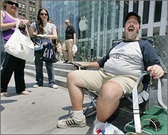 Not waiting: Greg Packer of Huntington, N.Y. sits at the front of the iPhone line at the Apple Store in New York.