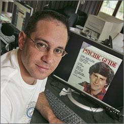 Brian Sapient is shown with an image of self-proclaimed psychic Uri Geller. Sapient and others recently posted several video clips to YouTube demonstrating how Uri Geller uses simple sleight of hand in his act.