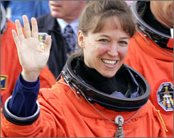 "Lisa Nowak waves at the Kennedy Space Center, Fla., on July 2, 2006. Nowak told police investigators that she still felt like former astronaut Bill Oefelein's ""companion"" during a rambling interview moments after being arrested for attempted kidnapping in February."