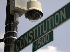 A camera is installed at a busy intersection in Washington.