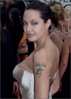 If only Angelina Jolie had waited until this fall, she could have had no regrets about this 'Billy Bob' tatoo. A new permanent but removable ink is set to hit parlors later this year.