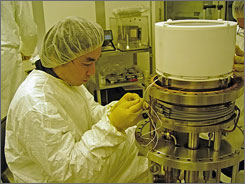 """Dr. Masaki Yamashita, a research scientist, works during the final assembly of the XENON10 Detector in the """"clean room"""" of the Astrophysics lab at Columbia University in New York."""