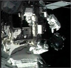 Spacewalker Dave Williamas, left, secures the faulty control gyro to a bracket as spacewalker Rick Mastracchio looks on during the second EVA.