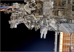 Astronauts Rick Mastracchio and Canadian Space Agency's Dave Williams (out of frame), both STS-118 mission specialists, participate in the mission's first planned session of extravehicular activity (EVA) Saturday, as construction continues on the International Space Station.