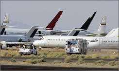Firefighting crews move towards the site of an explosion that killed two people and critically injured four others at Mojave Air and Space Port in Mojave, Calif. The accident at the remote site rattled the fledgling space tourism industry.