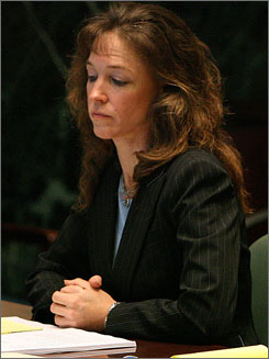 Lisa Nowak sits in the courtroom during a hearing at the Orange County courthouse in Orlando on Aug. 24, 2007. Nowak is pursuing an insanity defense.