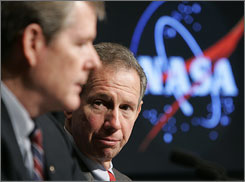 NASA administrator Michael Griffin, right, listens as Bryan O'Connor speaks during a news conference to announce that no evidence was found that astronauts were drunk or had been drinking heavily before any space launch.