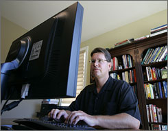 Rich Skrenta works on his home computer at home in San Carlos, Calif. Skrenta is credited with creating the first computer virus in 1982.
