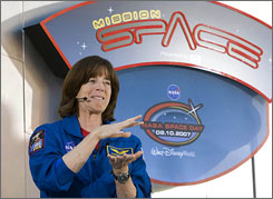 NASA space shuttle astronaut Barbara Morgan talks at Walt Disney World's Epcot Center in Lake Buena Vista, Florida. Walt Disney World honored the entire STS-118 during the day's festivities.