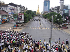 A photo from the MoeMaka Media blog shows police, center, blocking the road to the Shwedagon Pagoda in downtown Yangon. Myanmar security forces used batons, tear gas and live rounds in a violent crackdown on protests against the military junta.