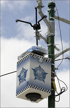 A Chicago Police Department surveillance camera is seen mounted on a light pole on the city's South Side in June 2005. Chicago is teaming with IBM for possibly the most advanced security network anywhere in the U.S.