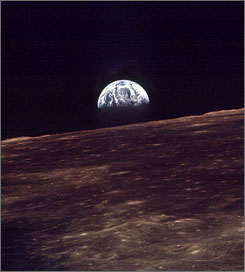 The earth rises over the horizon of the moon in this Dec. 24, 1968 file photo made by the astronauts on Apollo 8.