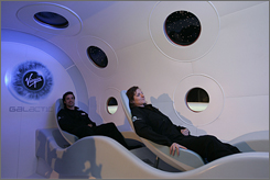 A mock-up of the cabin in Virgin Galactic SpaceShipTwo is on display at the Science Museum in London.