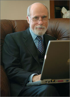 Vint Cerf works on his computer in his McLean, Va. home. After fending off an international rebellion and planting the seeds for streamlining operations, Cerf is stepping down this week as chairman of the ICANN this week.