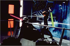 Darth Vader (David Prowse) and Luke Skywalker (Mark Hamill) battle in the climatic scene of 'Return of the Jedi.'