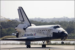 Discovery lands at the Kennedy Space Center on Wednesday.