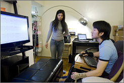 Landy Ung and her boyfriend Wan Hsi Yuan work on their startup company out of their studio apartment in New York.