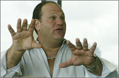 "Steve Buding gestures as he speaks during an interview in Miami. Budin, a self-styled offshore sports gambling ""pioneer"" who built a multimillion-dollar business, saw it all come crashing down when he was arrested in 1998."