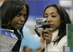 Jessica Boyd, left, and Dorcas Tejeda look over a digital camera at a Best Buy in Atlanta on Friday.