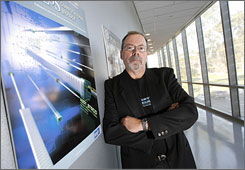 Dr. Phillip Bourne, creator of video-sharing site SciVee.com, poses outside his lab at the University of California, San Diego.  Bourne wanted a reputable virtual place where researchers could trade techniques without wading through general video-sharing sites.
