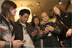 Teen-agers at a Metropark in San Francisco  from left, Britany Ernst, Christopher Tan, Christine Lau, Natalia Clough and Alexandra Slatoff, 16  respond to a promotion by sending text messages.