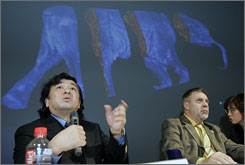 Naoki Suzuki, left, professor at Japan's Jikei University, explains about the 3-D images of frozen carcass of a 37,000-year-old baby mammoth in Tokyo . The baby mammoth, Lyuba, may shed light on why the species didn't survive.