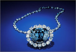 "The Hope Diamond glows a mysterious red when exposed to ultraviolet light, a finding that scientists say can help them ""fingerprint"" diamonds and tell the real ones from artificial."