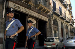 Carabinieri police guard Vincenzo Conticello's Antica Focacceria San Francesco sandwich restaurant in downtown Palermo, Sicily. Businesses in growing numbers are refusing to submit to demands for protection money with the power of the Web on their side.