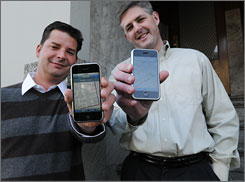 """Michael Shean, left, and Ted Morgan, with their iPhones, got a boost last week when Apple CEO Steve Jobs called their company's location technology """"really cool."""""""