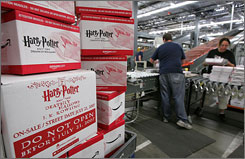 """Amazon.com employees pack copies of """"Harry Potter and the Deathly Hallows"""" for shipment July 16, 2007 at an Amazon fulfillment center in Fernley, Nevada. Critics thought it was over the top when Amazon.com  expanded from books only on its site."""