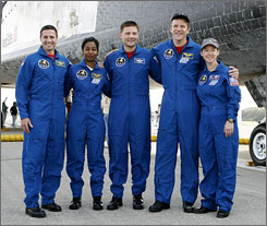 Members space shuttle Discovery's crew that completed an International Space Station mission in November, 2007. The crew members are (from left to right) Pilot George Zamka, Stephanie Wilson, Douglas Wheelock, Scott Parazynski and Commander Pamela Melroy. They're traits include sensitivity and congeniality, which is something NASA values more now than when it recruited rugged test pilots in the 1960s.