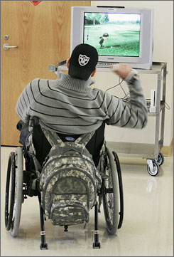 Pfc. Matthew Turpen, 22, of Des Moines, Iowa, who was paralyzed from the chest down in a car accident last year while stationed in Germany, plays golf on a Wii as part of his therapy at the Hines Veterans Affairs Hospital in Hines, Ill.