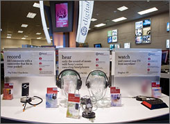 At Borders' new digital center, customers can download music or books, burn CDs, print pictures or conduct research, all with the help of an expert.