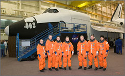 The STS-123 crew members in the Space Vehicle Mockup Facility at Johnson Space Center. From left are Mission Specialists Garrett E. Reisman, Richard M. Linnehan and Robert L. Behnken, Pilot Gregory H. Johnson, Commander Dominic L. Gorie, Mission Specialists Michael J. Foreman and Takao Doi.