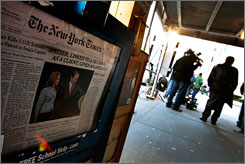 Members of the media wait outside of New York Gov. Eliot Spitzer's apartment building in New York. Spitzer is allegedly linked to a prostitution ring.