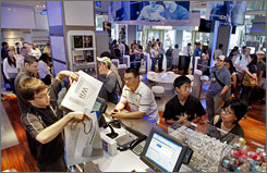 Customers lined up to purchase Wii video game consoles at the Nintendo World store in New York's Rockefeller Center last June. Wii was still the best-selling console in February, moving 432,000 units.